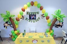 curious George palm tree balloon arch decoration string of pearls