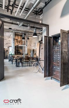 This is the epitome of an industrial loft. Nice vintage accents throughout.