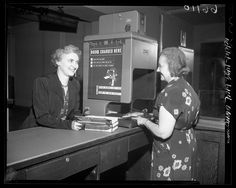 Los Angeles Public Library clerk using photo-charging machine, 1950