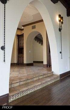 Spanish #hacienda style home with pavers and decorative #tiles. By Homer Clifton Oatman, AIA. #stairs #risers