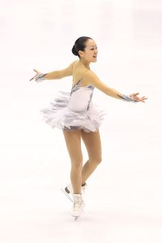 SAPPORO, JAPAN - DECEMBER 23: Mao Asada competes in the Women's Free Program during day three of the 81st Japan Figure Skating Championships at Makomanai Sekisui Heim Ice Arena on December 23, 2012 in Sapporo, Japan.