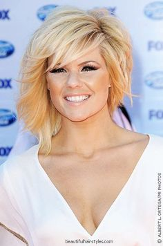 i just might get my hair cut like this sometime soon... shorter on one side than on the other.