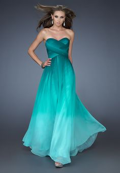Be bold and sexy in this strapless chiffon gown with beautiful ombre print and sweetheart neck. Dress has a high waist with a basket weave design covering the bust. Center back zip closure.