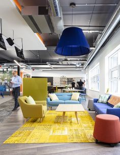 Industrial office Lounge - A Look Inside Compassion's New Fleet HQ. Modern Office Decor, Industrial Office Design, Office Space Design, Office Interior Design, Office Interiors, Workplace Design, Office Ideas, Industrial Lighting, Modern Lighting