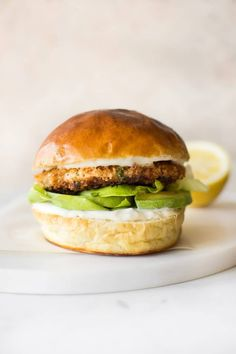 """Easy Salmon Burger Recipe guardians-of-the-food: """"These easy salmon burgers are made from simple ingredients and come together fast. The zingy Cajun seasoning in the burgers paired with the lemon garlic mayo sauce makes these burgers irresistible! Gourmet Burgers, Burger Recipes, Seafood Recipes, Burger Bar, Pesto Pasta, Wrap Recipes, Dinner Recipes, Creamy Garlic Sauce, Lemon Sauce"""