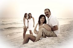 Google Image Result for family beach portrait- I like how they used the sand to create levels and dimension