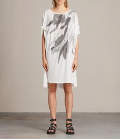 AllSaints New Arrivals: Wing Catkin Tee Dress. A super relaxed silhouette, this tee dress is crafted in lightweight jersey to complement the easy shape. Double knotting on the sleeves adds subtle detail, while the feathered wing print from the shoulder adds a statement edge.