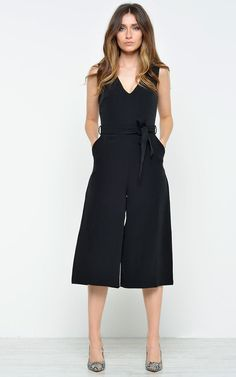 A classic black culotte jumpsuit is never a bad idea... This will look stunning with a pair of white trainers and a denim jacket, or with some killer heels and red lippy.