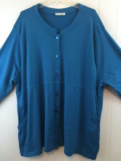Be comfy with this #UllaPopken stretch cotton knit tunic top. #WomensPlus 3X 4X. Solid blue color with pockets!