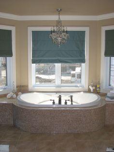 Chandelier in bathroom over tub