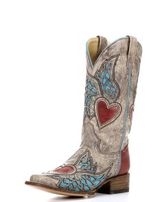 """The Sand/Red Turquoise Side Wing & Heart Square Toe Boot by Corral is full of fresh details and charm. Hearts flutter across the 11.5"""" sand-color shaft, while black stitching accentuates the rich inlay details. The red heel ties it all together with irresistible energy. Every Corral bootis handcrafted to exacting standards andfeatures a cushioned insole. Get the hottest new cowgirl style by Corral!"""