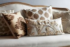 New Neutrals ... here's an effortless way to update a room (pillows & throws). Mix neutral shades-ivories, grays, taupes -- but use textures, patterns, and detailing.