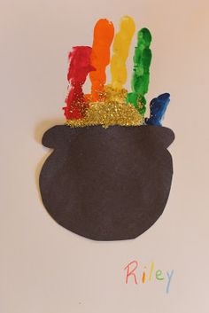 handprint rainbow and pot of 'glitter' gold