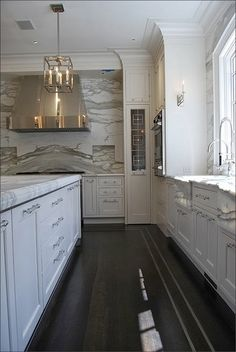 The Ultimate Guide to Kitchen Cabinet Hardware. -via Interior Canvas. Love the marble carried up wall.