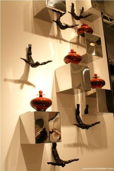 Love the diving sculptures in this wall display - unexpected and fun!