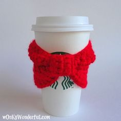 It's that time of year again. Time to sip on piping hot cocoa, tea or coffee.I am sharing a quick and easy crocheted cup cozy pattern so that you don't burn your hands for the next four months. This is also a perfect project for beginners.  Red Bow Cup Cozy Pattern I used Caron …