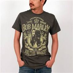 This smoke colored Catch A Fire Men's Tee showcases a vintage theme of Bob Marley and The Wailers. The Lion of Judah is pictured on each side of Bob Marley and the crown is set at the top framed with the words, Trenchtown, Soul Rebel, Bob Marley and the Wailers.