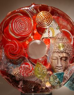 Susan Gott | sand-cast glass with buddha, leaves, spirals