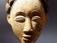 African Mukudj Mask, Punu, Gabon, Africa. In the Punu communities of southern Gabon, mukudj masks are considered portraits of an exceptionally beautiful female member. This mask is defined by an elaborate and highly stylized bi-lobed coiffure, painted black, which frames an idealized female face of Punu women, and...read more in description Mask in https://www.tribalfeel.com/p2068129-mukudj-mask-punu-gabon-africa.html 4BANNERHOME-10007-africa-mask-art-punu-800x600.jpg