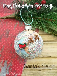 27+ DIY Christmas Ornaments Kids Can Craft- Decoupage Santa's Sleigh Map Christmas Ornament from Gym Craft Laundry