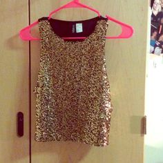 Gold sequin crop top Gold sequin h&m crop top. Brand new and never worn. Black back H&M Tops Crop Tops