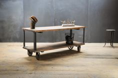 USA, 1930s, Vintage Industrial Pullman Display Table Cart. Extremely Functional Display or Work Table. Two Tiered Old Growth Oak Butcher Blocks Mounted to Cast Iron Uprights. Bentley Swivel Casters. Solid, Stable, and Heavy. Time Worn Patina.  factory20.com