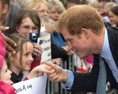 Abby and Gracie admiring Prince Harry.