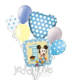 """Included in this bouquet: 7 Balloons Total 1 – 18"""" Mickey Mouse """"1"""" Square Balloon 1 – 18"""" Light Blue Polka Dot Heart Balloon 5 - 12"""" Mixed Latex Balloons (Light Blue, Light Blue Polka Dots on White,"""