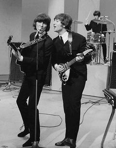 George and John with Ringo on the drums in the background