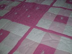 Close up of pink baby quilt.