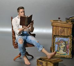 """Hard to believe this is a 1:12 scale dollhouse miniature. It sold for U.S. $888.99 in June 2015. OOAK doll by seller http://www.ebay.com/usr/amstram_studio. This was titled """"The Collector""""."""