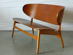 Hans Wegner Shell Settee | From a unique collection of antique and modern settees at https://www.1stdibs.com/furniture/seating/settees/