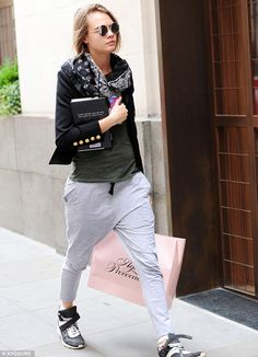 Splashing out: Cara Delevingne was spotted with a large shopping bag from lingerie store A...