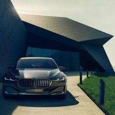 EQUITONE facade materials and a new BMW in one promotional image. BMW unveils Vision Future Luxury car with augmented reality display. www.equitone.com #design #architecture #material www.equitone.com