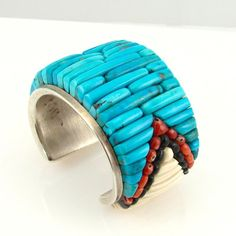 Cuff bracelet |  Sierra Pete (Navajo).  Sterling silver, inlaid turquoise, coral, jet and fossilized ivory