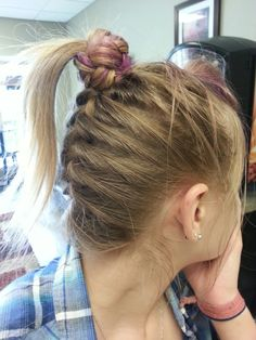 Upside down braid wrapped around ponytail. Bangs teased and pinned back. So cute and punk!