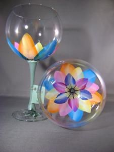 Price is for a set of two. Look into the glass and you will see a colorful open flower.Each glass hand painted and signed. These are 19 oz Ballon Red Wine glasses. The stem is painted green to give the effect of flowers decorating your table Diy Wine Glasses, Decorated Wine Glasses, Hand Painted Wine Glasses, Buy Glasses, Wine Glass Crafts, Wine Craft, Wine Bottle Crafts, Wine Bottles, Verre A Vin Design