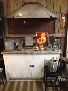 Vintage metal chicken feeder piece as a wall mounted awning.  Would make a great stove hood!