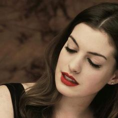 Anne Hathaway makeup.... I think she's a pretty good celebrity look alike for you makeup wise since you've got similar color eyes and hair.