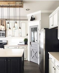 Modern farmhouse kitchen design - love this chandelier and the sconce over the pantry door