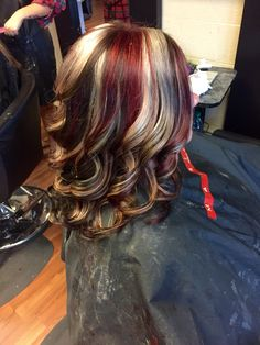 Brown base with blonde and red chunky highlights
