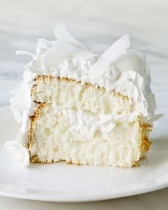 Coconut Cloud Cake Recipe ~ This light, flavorful dessert, filled and topped with seven-minute frosting and coconut, is a little slice of heaven!