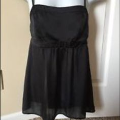 CAbi Coy Cami CAbi Coy Cami -- size Medium. Black. Silk material and cinch below the bust is super flattering. This can be worn by size small or medium and can be a top or tunic! Perfect for date night or girls night out, but can also be paired with jeans/shorts for a casual look. NWOT/never worn. CAbi Tops Tank Tops