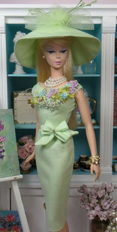 Vintage style sheath in pastel green polished cotton, fully lined in china silk, with embroidered bodice, self bow at hip and button over snap