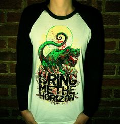 bring me the horizon shirt - and with a dinosaur, oli's fav.