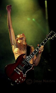 Angus Young... He's one of the most awesome people I have ever seen!