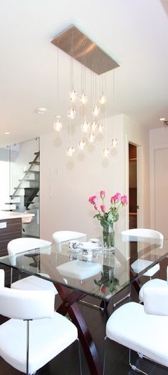 glass table dining room with modern lights