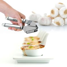 Never chop another awkward clove of garlic again with the Bru Joy Best Garlic Press