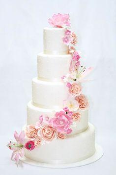 Floral cascade wedding cake made by The Sugared Saffron Cake company