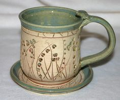 Stoneware Pottery Mug and Matching Coster by VirginiaRoseStudio, $22.00 PINNER SAYS~I enjoy throwing mugs. They make wonderfully personalized gifts and once you get the hang of throwing a cylinder, the possibilities for shapes, handles, design, and color combos are endless.